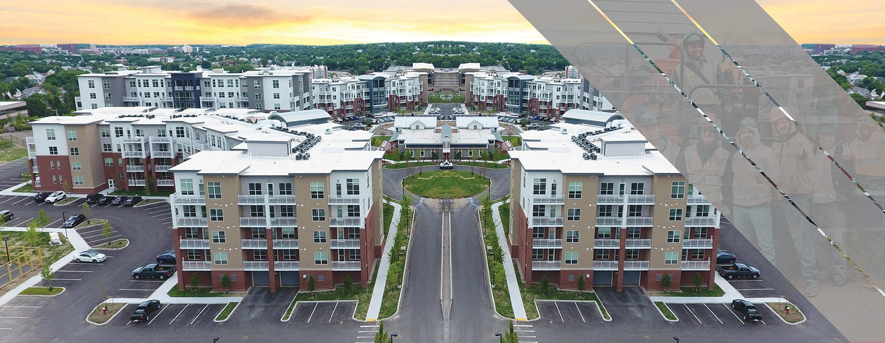 Aerial view of apartment complex with gray angled lines