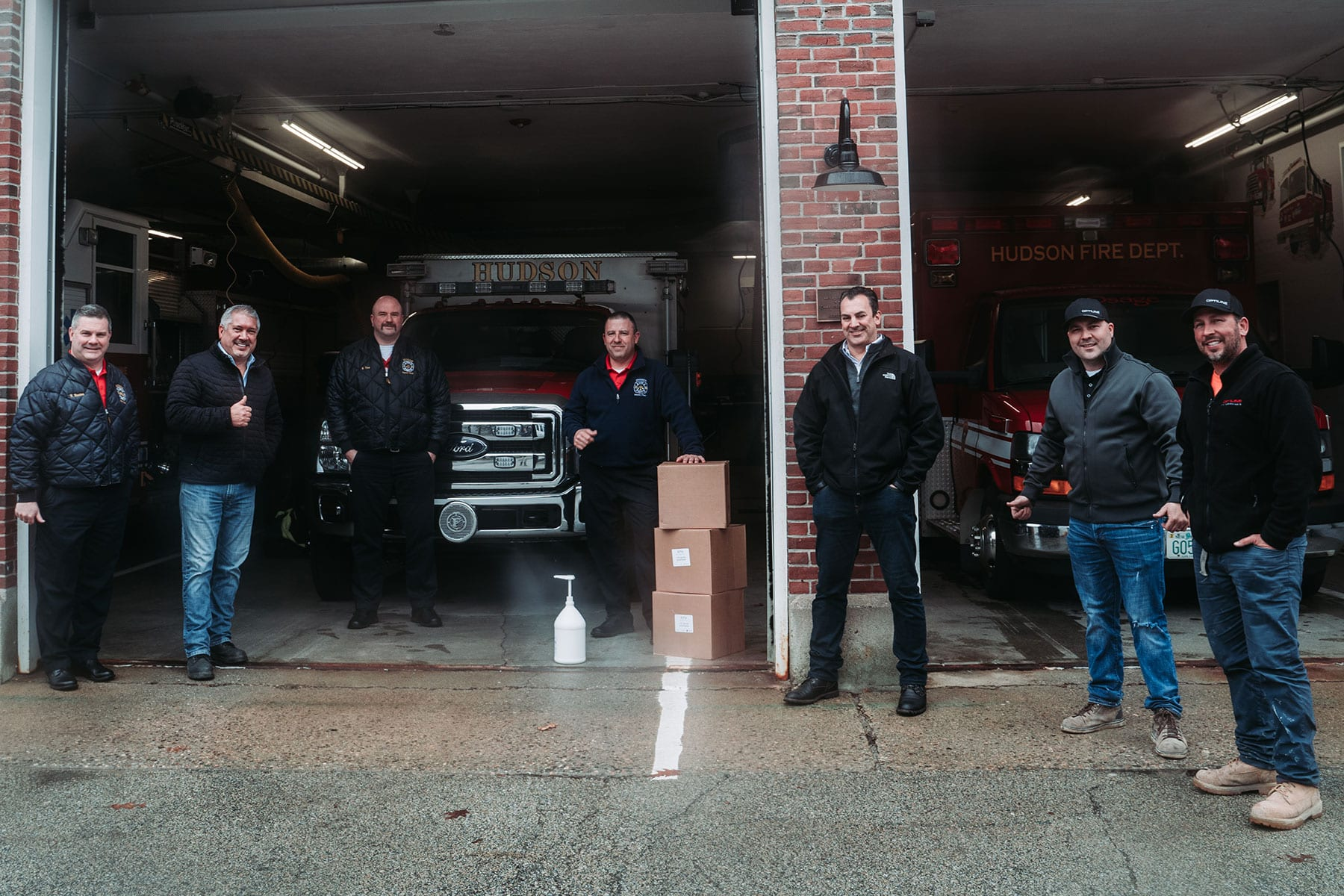 The Optiline team standing in front of their local fire department
